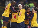 Arsenal players celebrate their win over Roma on penalties on March 11, 2009.
