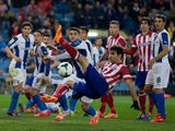 Diego Costa of Atletico de Madrid strikes the ball during the La Liga match between Club Atletico de Madrid and RCD Espanyol at Vicente Calderon Stadium on March 15, 2014