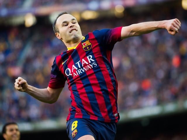 Andres Iniesta of FC Barcelona celebrates after scoring his team's third goal during the La Liga match between FC Barcelona and CA Osasuna at Camp Nou on March 16, 2014