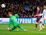 Lionel Messi of Barcelona flicks the ball past goalkeeper Joe Hart of Manchester City to score the opening goal during the UEFA Champions League Round of 16, second leg match between FC Barcelona and Manchester City at Camp Nou on March 12, 2014