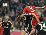 Bayern Munich's Croatian striker Mario Mandzukic heads ball to score past Leverkusen's defender Philipp Wollscheid during the German first division Bundesliga football match FC Bayern Munich vs Bayer 04 Leverkusen in Munich, southern Germany on March 15,