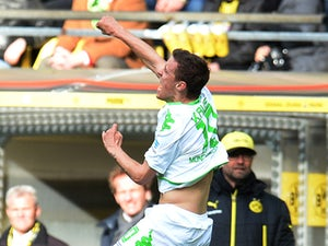 Monchengladbach striker Max Kruse celebrates during the German first division Bundesliga football match Borussia Dortmund vs Borussia Moenchengladbach in Dortmund, western Germany on March 15, 2014