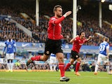 Juan Cala of Cardiff City celebrates scores his team's first goal during the Barclays Premier League match between Everton and Cardiff City at Goodison Park on March 15, 2014