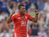 Chris Jordan of England celebrates after dismissing Johnson Charles of the West Indies during the 3rd T20 International match between the West Indies and England at Kensington Oval on March 13, 2014