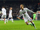 Tottenham's Christian Eriksen celebrates after scoring his team's opening goal against Benfica during their Europa League match on March 13, 2014