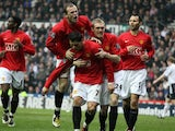 Cristiano Ronaldo and his Manchester United teammates celebrate his goal against Derby County on March 15, 2013.