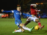 Dany N'Gussan of Swindon Town battles with Danny Kearns of Peterborough United during the Johnstone's Paint Southern Area Final between Peterborough United and Swindon Town at London Road on February 5, 2014