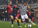 Genoa's Giovanni Marchese and Juventus' Arturo Vidal in action during the Serie A match on March 16, 2014