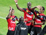 Guingamp's French midfielder Claudio Beauvue celebrates with teammates after scoring during the French L1 football match Ajaccio (ACA) vs Guingamp (EAG) at the Francois Coty stadium in Ajaccio, Corsica island, on March 15, 2014