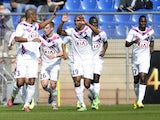 Bordeaux's Henrique celebrates with teammates after scoring against Montpellier in the Ligue 1 match on March 16, 2014