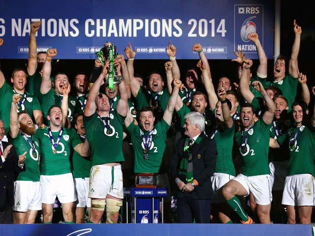 Brian O'Driscoll and captain Paul O'Connell of Ireland celebrate with their team-mates as they lift the trophy after winning the six nations championship with a 22-20 victory over France during the RBS Six Nations match between France and Ireland at Stade