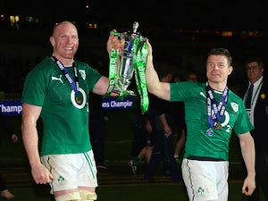 Captain, Paul O'Connell of Ireland and Brian O'Driscoll celebrate with the Six Nations Championship during the RBS Six Nations match between France and Ireland at Stade de France on March 15, 2014