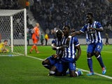 Porto's Jackson Martinez celebrates with teammates after scoring the opening goal against Napoli during their Europa League match on March 13, 2014