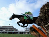 Barry Geraghty on Jezki jumps the last on his way to victory in The Stan James Champion Hurdle Challenge Trophy during The Festival Champion Day at Cheltenham Racecourse on March 11, 2014