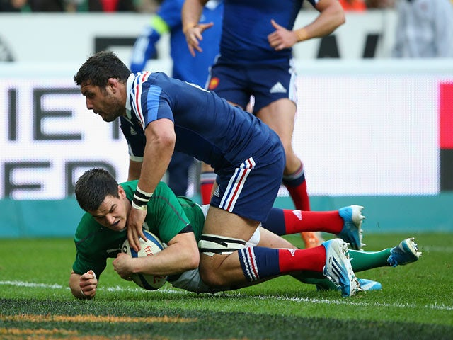 Ireland's Jonny Sexton scores the first try against France during the Six Nations match on March 15, 2014
