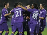 Fiorentina's Juan Cuadrado is congratulated by teammates after scoring the opening goal against Chievo Verona during the Serie A match on March 16, 2014