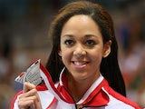 Katarina Johnson-Thompson of Great Britain poses with her silver medal in the Women's Long Jump Final during the medal ceremony on day three of the IAAF World Indoor Championships at Ergo Arena on March 9, 2014