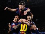 Barcelona players celebrate Lionel Messi's goal against AC Milan on March 12, 2013.