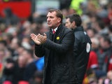 Liverpool Manager Brendan Rodgers encourages his players during the Barclays Premier League match between Manchester United and Liverpool at Old Trafford on March 16, 2014