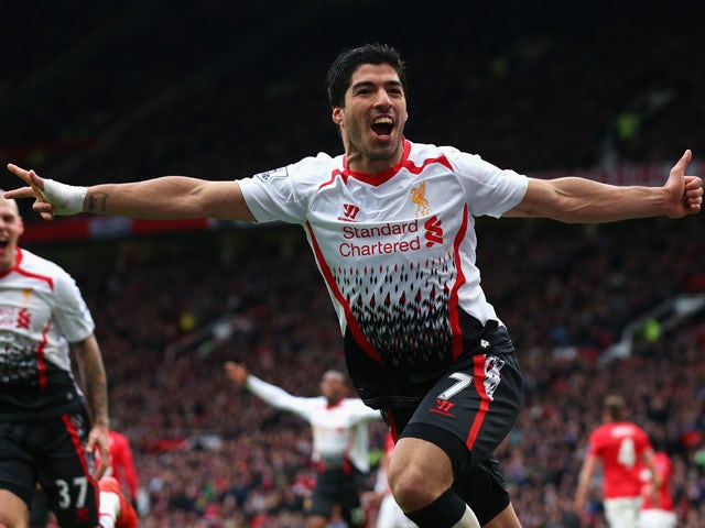 Luis Suarez of Liverpool celebrates scoring his team's third goal during the Barclays Premier League match between Manchester United and Liverpool at Old Trafford on March 16, 2014