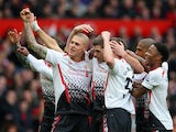 Steven Gerrard of Liverpool celebrates scoring the first goal with his team-mates during the Barclays Premier League match between Manchester United and Liverpool at Old Trafford on March 16, 2014