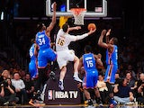 Pau Gasol of the Los Angeles Lakers (#16) drives to the hoop under pressure from Kevin Durant (#34), Hasheem Thabeet (#34), Reggie Jackson (#15) and Serge Ibaka (R) of the Oklahoma City Thunder during their NBA matchup at Staples Center in Los Angeles, Ca