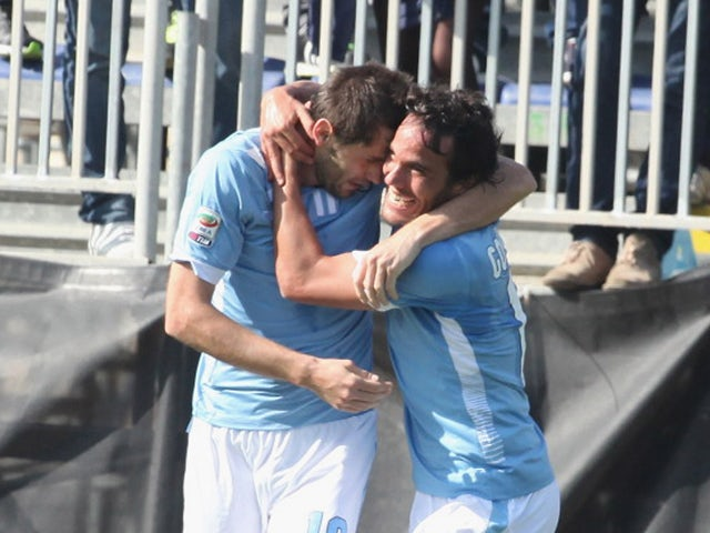 Lulic Senad of Lazio celebrates with the team mates his opening goal during the Serie A match between Cagliari Calcio and SS Lazio at Stadio Sant'Elia on March 16, 2014