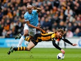 Nikica Jelavic of Hull City is brought down by Vincent Kompany of Manchester City during the Barclays Premier league match between Hull City and Manchester City at KC Stadium on March 15, 2014