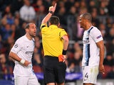 Pablo Zabaleta of Manchester City is sent off by referee Stephane Lannoy during the UEFA Champions League Round of 16 match between FC Barcelona and Manchester City at Camp Nou on March 12, 2014