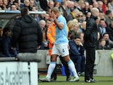 Vincent Kompany of Manchester City gestures with his hand as he leaves the field after being shown a red card during the Barclays Premier League match between Hull City and Manchester City at the KC Stadium on March 15, 2014