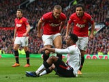 Nemanja Vidic of Manchester United and Rafael react to Daniel Sturridge of Liverpool after the award of the second penalty kick during the Barclays Premier League match between Manchester United and Liverpool at Old Trafford on March 16, 2014