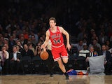 Mike Dunleavy #34 of the Chicago Bulls dribbles the ball against the New York Knicks at Madison Square Garden on December 11, 2013