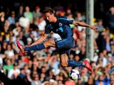 Luuk de Jong of Newcastle swings at and misses the ball during the Barclays Premier league match between Fulham and Newcastle United at Craven Cottage on March 15, 2014
