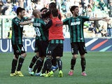 Sassuolo's Nicola Sansone is congratulated by teammates after scoring his team's third goal against Catania during the Serie A match on March 16, 2014