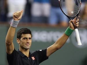 Djokovic races into semi-finals