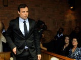 South African athlete Oscar Pistorius appears in Pretoria Magistrates Court for an indictment hearing on August 19, 2013