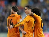 Cristiano Ronaldo of Real Madrid celebrates with Xabi Alonso and Marcelo after scoring Real's opening goal during the La Liga match between Malaga and Real Madrid at La Rosaleda Stadium on March 15, 2014