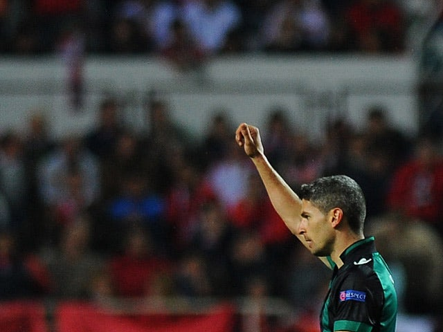 Betis' Salva Sevilla celebrates after scoring his teams second goal against Sevilla during their Europa League match on March 13, 2014