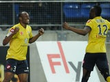 Sochaux's Zambian defender Stoppila Sunzu celebrates after scoring a goal during the French L1 football match between Sochaux (FCSM) and Lorient (FCL) on March 15, 2014