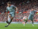 Liverpool's Steven Gerrard scores his team's second goal via the penalty spot against Manchester United during their Premier League match on March 14, 2009