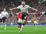Steven Gerrard celebrates scoring his and Liverpool's second goal against Manchester United in the Premier League at Old Trafford on March 16, 2014
