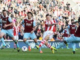 Marko Arnautovic of Stoke City beats Kevin Nolan, James Tomkins and Guy Demel of West Ham United to score their second goal during the Barclays Premier League match between Stoke City and West Ham United at Britannia Stadium on March 15, 2014