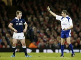 Referee Jerome Garces shows a yellow card to Scotland's Stuart Hogg after a late tackle on Wales' Dan Biggar, the yellow card was soon after changed to a red card during the Six Nations international rugby union match between Wales and Scotland at the Mil