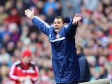 Sunderland manager Gus Poyet gestures during the Barclays Premier League match between Sunderland and Crystal Palace at The Stadium of Light on March 15, 2014