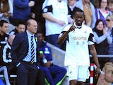 Roland Lamah of Swansea City celebrates his goal during the Barclays Premier League match between Swansea City and West Bromwich Albion at Liberty Stadium on March 15, 2014