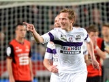 Toulouse's French midfielder Clement Chantome celebrates after scoring a goal during the French L1 football match Rennes (SRFC) vs Toulouse (TFC) at the Route de Lorient stadium in Rennes, western France, on March 15, 2014
