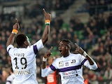Toulouse's French defender Serge Aurier celebrates with teammate after scoring a goal during the French L1 football match Rennes (SRFC ) vs Toulouse (TFC) at the Route de Lorient stadium in Rennes, western France, on March 15, 2014
