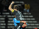 Valenciennes' Brazilian goalkeeper Novaes Magno and Valenciennes' Uruguayan defender Gary Kagelmacher celebrate following the French L1 football match Evian-Thonon (ETGFC) vs Valenciennes (VAFC) at the Parc des Sports in Annecy, central eastern France, on