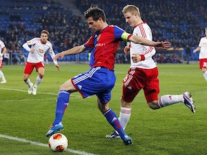 Basel's Valentin Stocker and FC Salzburg's Martin Hinteregger in action during their Europa League match on March 13, 2014