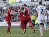 Stephane Sessegnon of West Bromwich Albion celebrates his goal with Youssouf Mulumbi (left) and Liam Ridgewell during the Barclays Premier League match between Swansea City and West Bromwich Albion at The Liberty Stadium on March 15, 2014